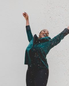 happy young woman with confettis